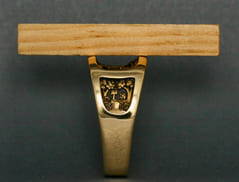 A straight edge across the top of the Whitetail Deer Ring shows how far the sculpture is recessed below the surface for protection from wear.